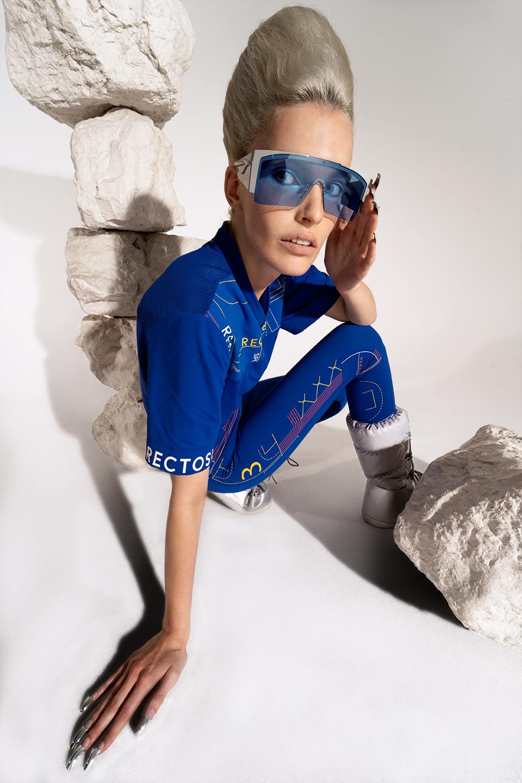 rv-c3-women-space-blue-glasses-sittingground